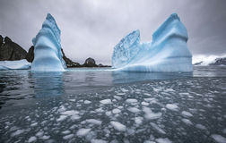 Landscape of icebergs and rocks in the sea. Pieces of ice float in the water. Andreev. Stock Photography