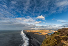 Landscape in Iceland with Blue Cloudy Sky, Ocean Waves and Mountains. Royalty Free Stock Images