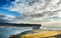 Landscape in Iceland with Ocean Water, Rocks and Black Sand Beach. Stock Photos