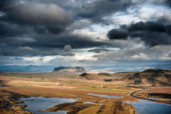 Landscape in Iceland with Stormy Clouds in the Sky, Road and Mountain. Stock Images