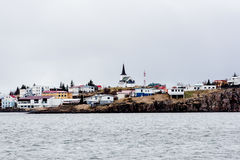 Landscape of Icelandic town. Panoramic landscape of an Icelandic town by the sea with a church spire dominating the skyline Royalty Free Stock Photo