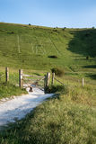 Landscape image of ancient chalk carving in hillside Long Man if Royalty Free Stock Photo