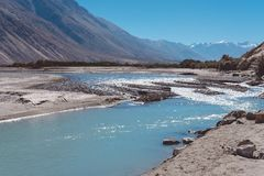 Landscape image of the blue Shyok river on the way to Nubra valley with mountain and blue sky background Stock Photos