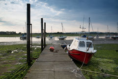 Landscape image of boats mored to jetty in harbor during Summer Royalty Free Stock Photos