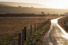 Landscape image of flooded country lane in farm Royalty Free Stock Image