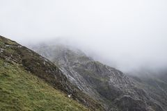 Landscape image of Llyn Idwal in Glyders mountain range in Snowd. Moody landscape image of Llyn Idwal in Glyders mountain range in Snowdonia during heavy stock images