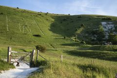 Landscape image of Long Man of Wilmington ancient chalk carving. On hillside on South Downs royalty free stock photo