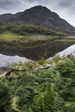 Landscape image of mountain reflected in still lake on Summer mo Stock Photography