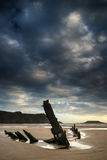 Landscape image of old shipwreck on beach at sunset in Summer. Landscape image of shipwreck on beach at sunset in Summer Royalty Free Stock Photos