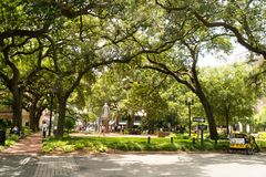 Savannah, Georgia / United States - June 25, 2018: Reynolds Square is one of may squares in the downtown district. Landscape image of Reynolds Square in royalty free stock images