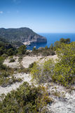 Landscape image of S'Aguila bay cove on Mediterranean island of Stock Image