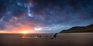 Landscape image of shipwreck on beach at Summer sunset Royalty Free Stock Photo