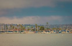 Over the water and to the island with boats stock photography