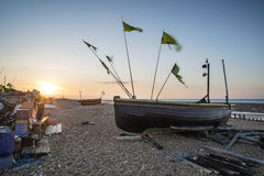 Landscape image of small fishing boats on beach at sunrise in Sp Royalty Free Stock Photos