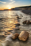 Landscape image of sunset over Birling Gap in England Stock Photos