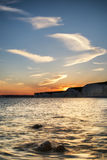 Landscape image of sunset over Birling Gap in England Stock Photo