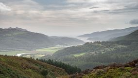 Landscape image of view from Precipice Walk in Snowdonia overlooking Barmouth and Coed-y-Brenin forest during rainy afternoon in. Beautiful landscape image of royalty free stock images