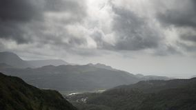 Landscape image of view from Precipice Walk in Snowdonia overlooking Barmouth and Coed-y-Brenin forest during rainy afternoon in. Beautiful landscape image of stock photos