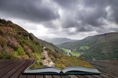 Landscape image of view from Precipice Walk in Snowdonia overlooking Barmouth and Coed-y-Brenin forest coming out of pages in. Beautiful landscape image of view stock image