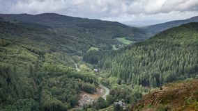 Landscape image of view from Precipice Walk in Snowdonia overlooking Barmouth and Coed-y-Brenin forest during rainy afternoon in. Beautiful landscape image of royalty free stock image