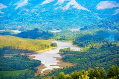 Landscape of India with tea plantations, tropical river, hills a stock photography