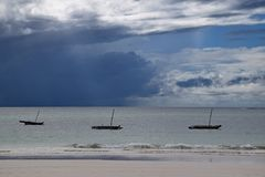 Landscape at Indian ocean, Sailboats on water, big clouds before storm. Landscape at Indian ocean, three Sailboats on water, big clouds before storm stock photos