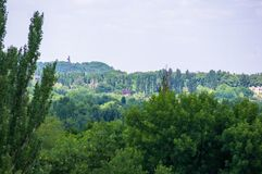 The landscape of the industrial city, green trees and mine waste heaps. On a warm summer day royalty free stock photo
