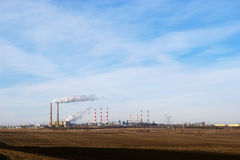 Landscape with an industrial enterprise on the horizon Stock Photos