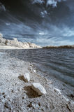 Landscape  in infrared of lake in English countryside in Summer Stock Images