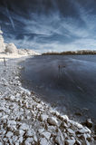 Landscape  in infrared of lake in English countryside in Summer Stock Photography