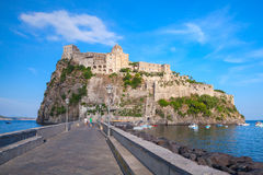 Landscape of Ischia port with Aragonese Castle. Coastal landscape of Ischia port with Aragonese Castle and empty road on the dam Royalty Free Stock Photography