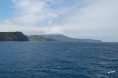 Landscape of the island of Faial. Azores, Portugal. View of the city of Horta from a sailboat`s edge. Faial Island, Azores, Portugal Royalty Free Stock Photo