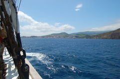 Landscape of the island of Faial. Azores, Portugal. View of the city of Horta from a sailboat`s edge. Faial Island, Azores, Portugal Stock Photography