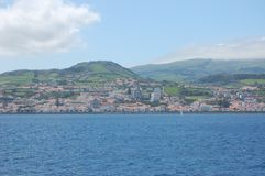 Landscape of the island of Faial. Azores, Portugal. View of the city of Horta from a sailboat`s edge. Faial Island, Azores, Portugal Stock Images