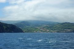Landscape of the island of Faial. Azores, Portugal. View of the city of Horta from a sailboat`s edge. Faial Island, Azores, Portugal Stock Photo