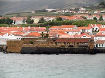 Landscape of the island of Faial. Azores, Portugal. View of the city of Horta from a sailboat`s edge. Faial Island, Azores, Portugal Royalty Free Stock Image