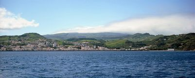 Landscape of the island of Faial. Azores, Portugal. View of the city of Horta from a sailboat`s edge. Faial Island, Azores, Portugal Stock Image