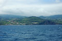 Landscape of the island of Faial. Azores, Portugal. View of the city of Horta from a sailboat`s edge. Faial Island, Azores, Portugal Royalty Free Stock Images