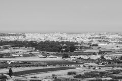 Landscape of island of Malta. Rural landscape with asphalt roads and fields on Malta. Maltese city on the background of Mediterranean sea. Black and white Royalty Free Stock Photo