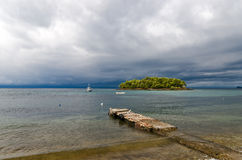 Landscape with an island and a storm Royalty Free Stock Image