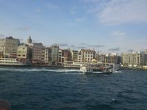 Landscape of istanbul with steamboat and Galata. City view with historical buildings and sea Stock Image
