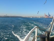 Landscape of istanbul from steamboat on sea Stock Photos