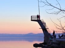 Landscape of an Italian lake at sunset with people royalty free stock image
