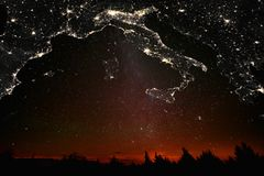 Landscape with Italian map constellations. Forest sunset landscape with projection of Italian map in the form of stars of the constellations of city lights royalty free stock images