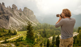 Landscape Italy, Dolomites - Men hiking Photographer take a picture Royalty Free Stock Images