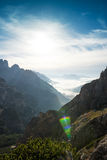 Landscape Italy, Dolomites - sunrise behind the rocks, sun flare Royalty Free Stock Photos