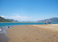 Landscape of Iztuzu Beach with a tourist boat, Dalyan, Turkey Stock Images