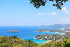 Landscape of Karon and Kata Beaches with blue sky background at Phuket Stock Photos