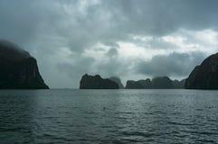 Landscape of karst islands of Halong Bay on mist Stock Image