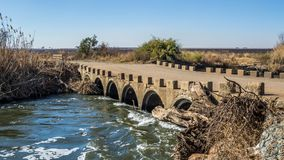 Landscape Klip River Gauteng South Africa. South African landscape of an old concrete low water bridge over the Klip River in Gauteng image with copy space in Stock Photography
